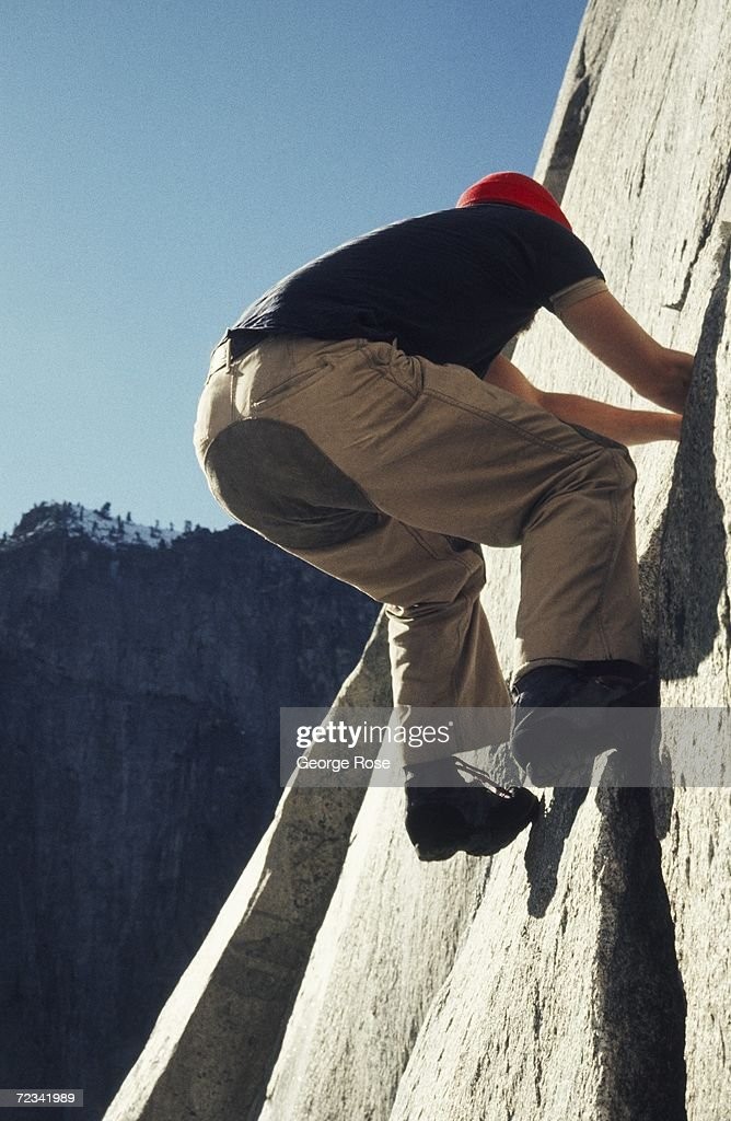 A rock climber free climbs El Capitan in this 1977 Yosemite, California, photograph. Yosemite is a popular destination for rock climbing.