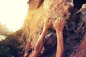 young woman rock climber hands climbing at seaside mountain cliff rock