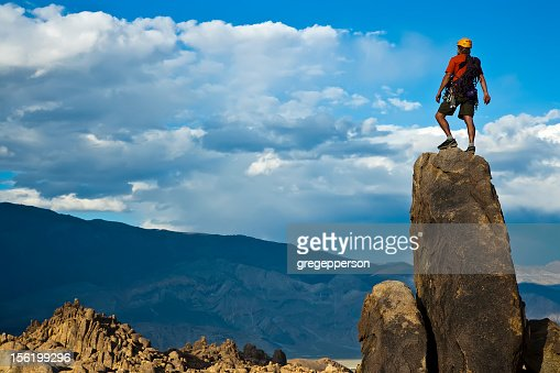 Rock climber on the top of the summit : Stock Photo