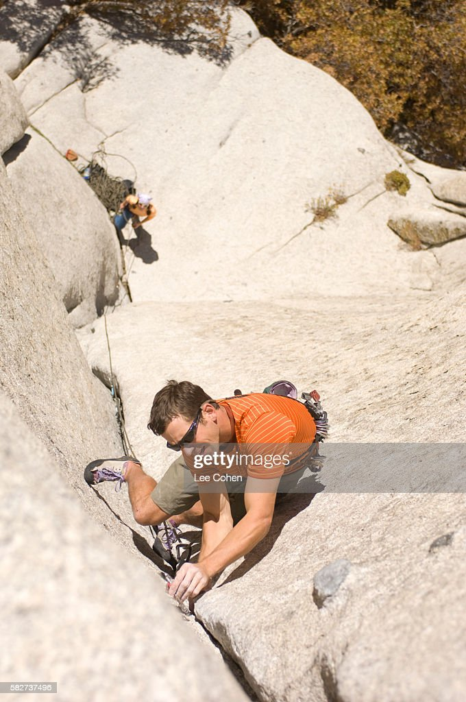 Rock Climber Placing Protective Anchor