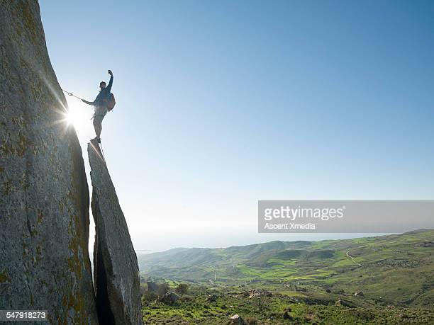 Rock climber takes selfie portrait on ridge crest