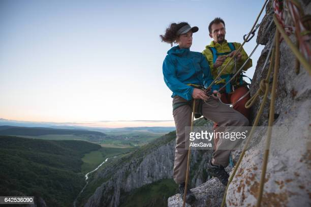 Rock climbers preparing to contine their acension