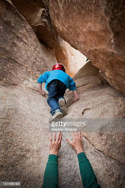 rock climbing 7-year-old, dad's supportive hands