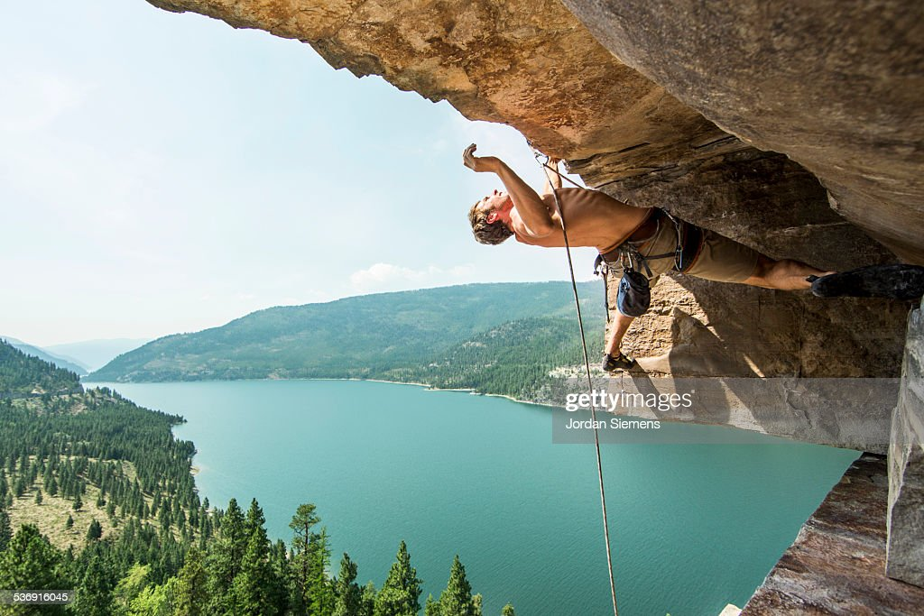 Rock Climbing at a scenic crag overlooking a lake.