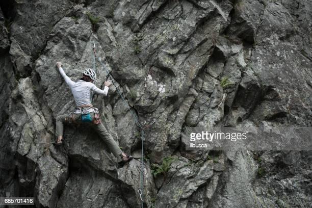 Rock climbing young woman on Italian Alps: Mountain climbing