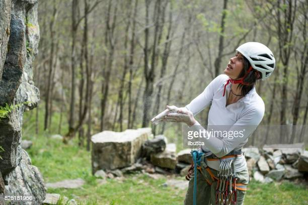 Rock climbing young woman on Italian Alps: Preparation