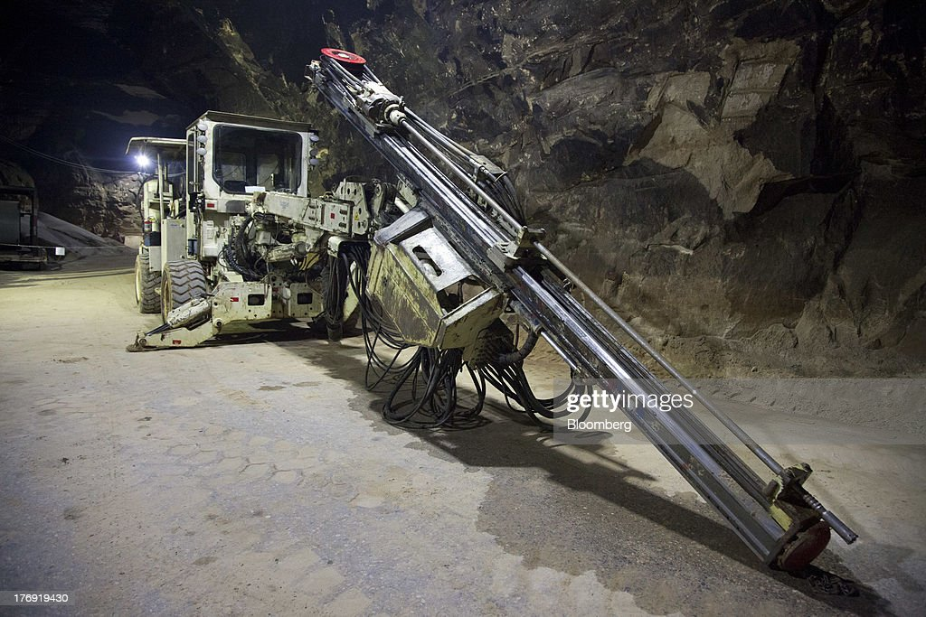A rock drill, used for drilling holes for explosive charges, sits in a mine at Wisconsin Industrial Sand Co.'s Maiden Rock facility in Maiden Rock, Wisconsin, U.S., on Thursday, Aug. 15, 2013. The 1,696 acre mine is one of only four underground industrial sand mines in the country. Because of the size and strength of the silica sand mined at this location, the industrial sand from this facility is used primarily in hydraulic fracturing operations in the oil and gas industry. Photographer: Ariana Lindquist/Bloomberg via Getty Images