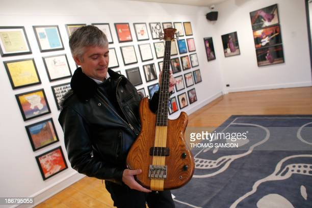 Rock Folk newspaper's journalist Hugues Corniere presents a british singer Sting former bass guitar during a Press preview at French auction house...