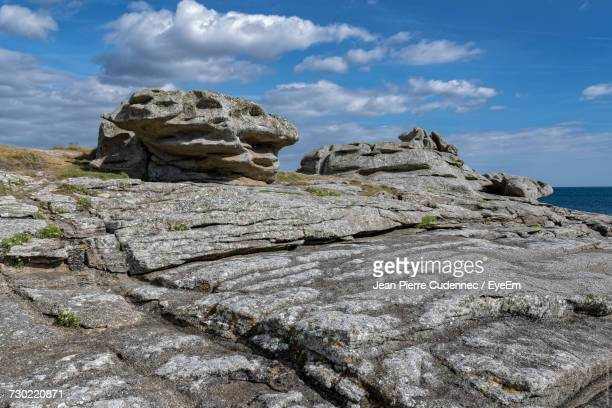 Rock Formation By Sea Against Sky