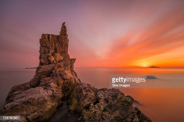 Rock formation on Yellow Sea at sunset, Dalian, Liaoning, China