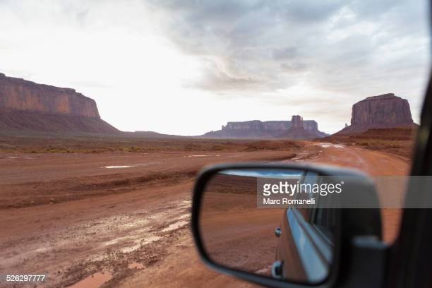 Rock formations and desert landscape viewed from car, Monument Valley, Utah, United States