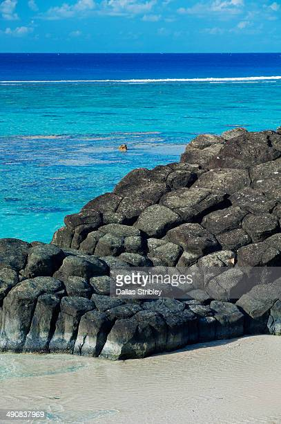 Rock formations and tropical island lagoon