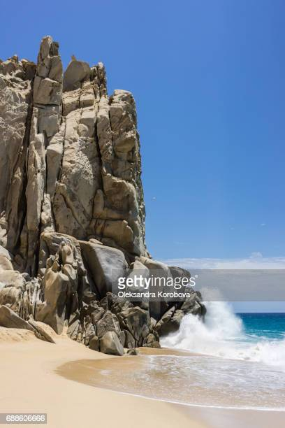 Rock formations and white sandy beach around the Arch in Cabo San Lucas, Mexico.