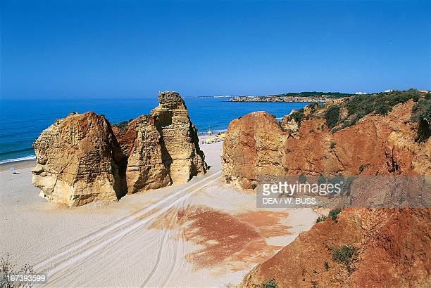Rock formations at Rocha beach next to Portimao marina Algarve Portugal