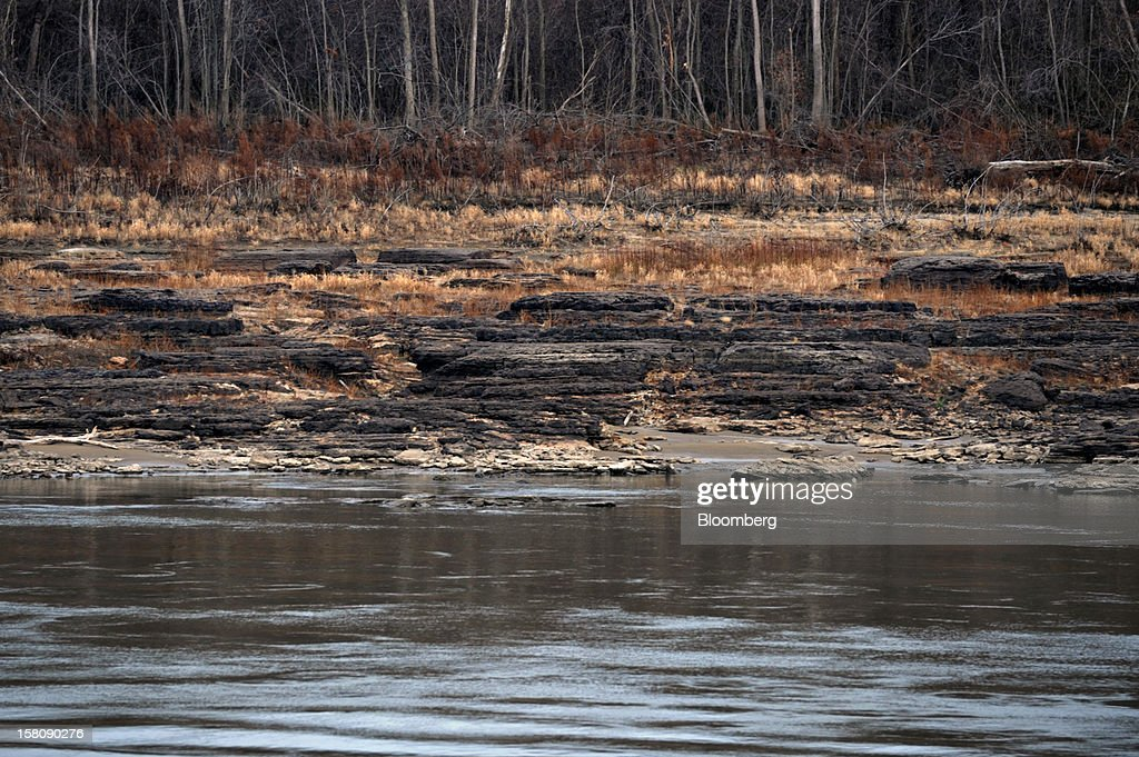 Rock formations called pinnacles sit exposed by low water levels in the Mississippi River north of Cairo, Illinois, U.S., on Friday, Dec. 7, 2012. Barges carrying grain, soybeans, coal, oil and other commodities on the Mississippi River have started to reduce their loads to navigate waters shrunk by the worst drought in 50 years. Photographer: Daniel Acker/Bloomberg via Getty Images