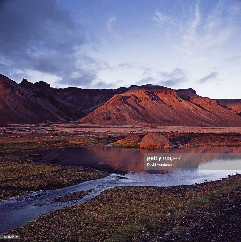 Rock formations reflected in still river : Stock Photo