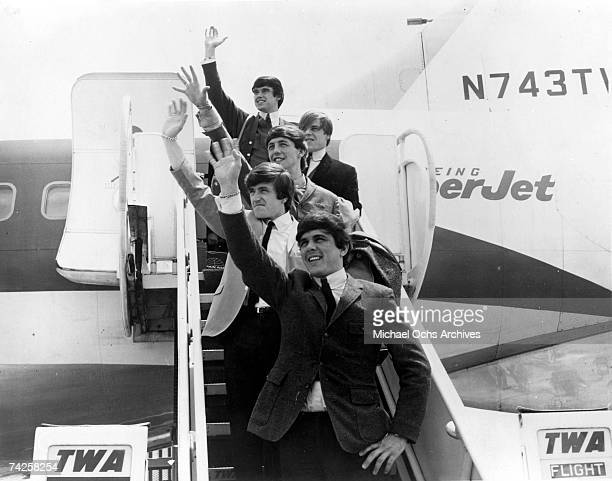Rock group 'Dave Clark 5' disembark from a TWA jet in circa 1964 Top to bottom Denis 'Denny' Payton Lenny Davidson Mike Smith Rick Huxley Dave Clark