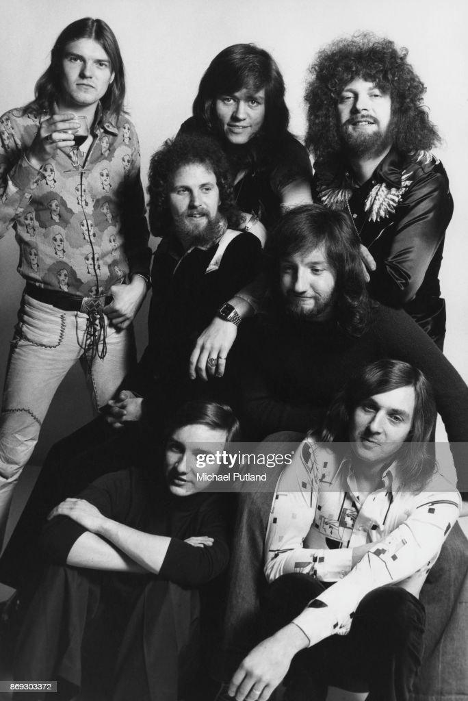 Rock group Electric Light Orchestra, February 1975. Not in order: singer and musician Jeff Lynne, drummer Bev Bevan, keyboard player Richard Tandy, bassist Kelly Groucutt (1945 - 2009), violinist Mik Kaminski, cellist Hugh McDowell, and cellist Melvyn Gale.