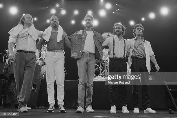 Rock group Genesis on stage at the end of a concert at the Rosemont Horizon Rosemont Illinois during the band's Invisible Touch Tour October 1986...