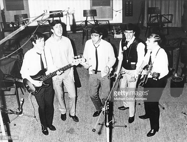 Rock group 'The Dave Clark Five' record in the studio in circa 1964 Rick Huxley Mike Smith Dave Clark Denis 'Denny' Payton Lenny Davidson