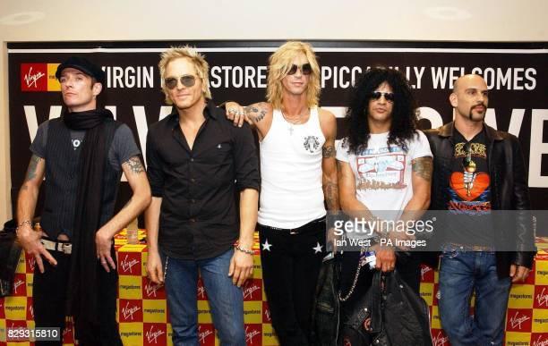 Rock group Velvet Revolver Scott Weiland Matt Sorum Duff McKagan Slash and Dave Kushner at Virgin Megastore in Piccadilly central London where they...