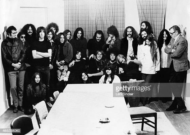 Rock groups MC5 and The Stooges pose for a photo with friends and record executives as they both sign contracts with Electra Records in October 1968...