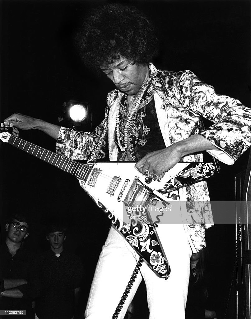 Rock guitarist Jimi Hendrix of the rock band 'The Jimi Hendrix Experience' performs onstage with a Gibson Flying V electric guitar at the Fifth...