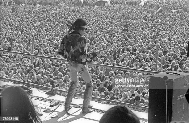 Rock guitarist Jimi Hendrix performs onstage with his Fender Stratocaster electric guitar at his last concert on September 6 1970 in Isle of Fehmarn...