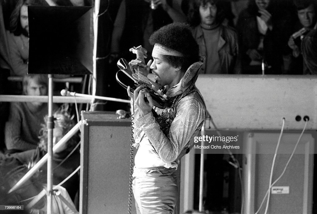 Rock guitarist Jimi Hendrix plays his Fender Stratocaster electric guitar with his teeth at his last concert on September 6, 1970 in Isle of Fehmarn, Germany.