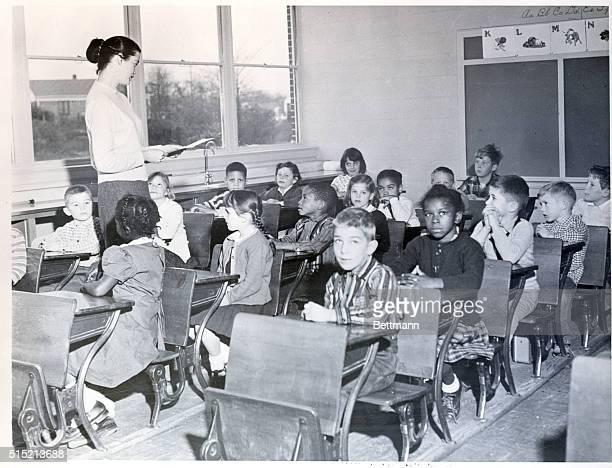 2/20/1957 Rock Hill SC Scene at St Anne Parochial School the only integrated school in South Carolina Joyce Dunne of Boston is the teacher in the...