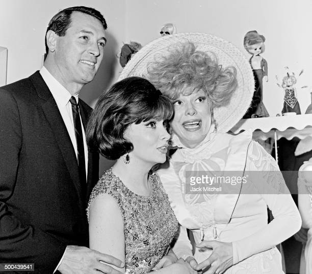 Rock Hudson and Gina Lollobrigida congratulate Carol Channing in her dressing room after a performance of the Broadway hit 'Hello Dolly' in 1965
