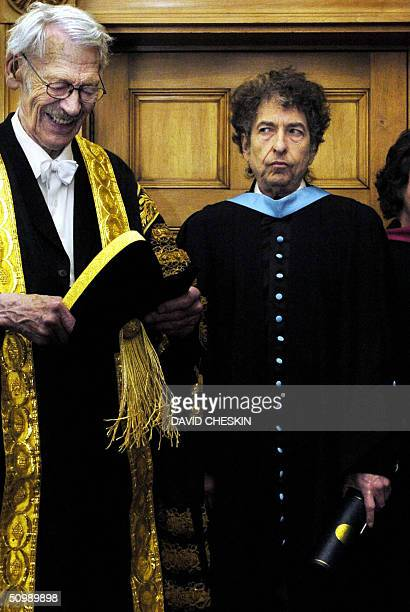 Rock legend Bob Dylan poses at the University of St Andrews 23 June after he received an honorary degree of Doctor of Music from Sir Kenneth Dover...