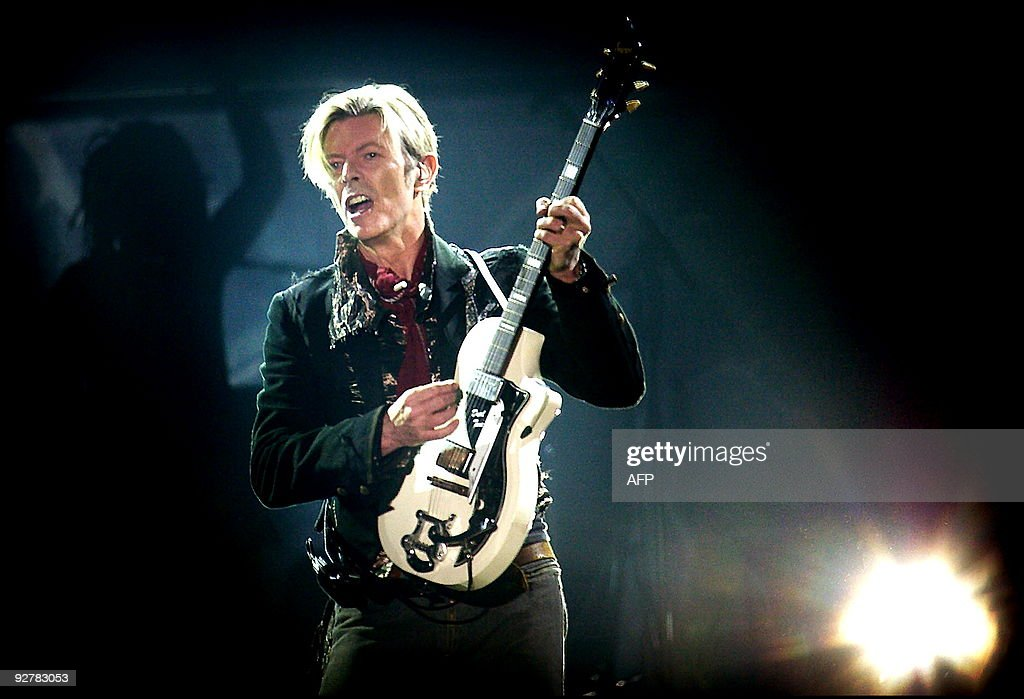 Rock legend <a gi-track='captionPersonalityLinkClicked' href=/galleries/search?phrase=David+Bowie&family=editorial&specificpeople=171314 ng-click='$event.stopPropagation()'>David Bowie</a> performs on stage at the Forum in Copenhagen late 07 October 2003. == DENMARK
