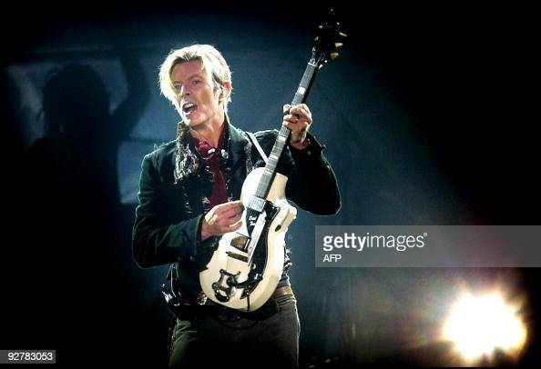 Rock legend David Bowie performs on stage at the Forum in Copenhagen late 07 October 2003 == DENMARK OUT == AFP PHOTO NILS MEILVANG/SCANPIX NORDFOTO