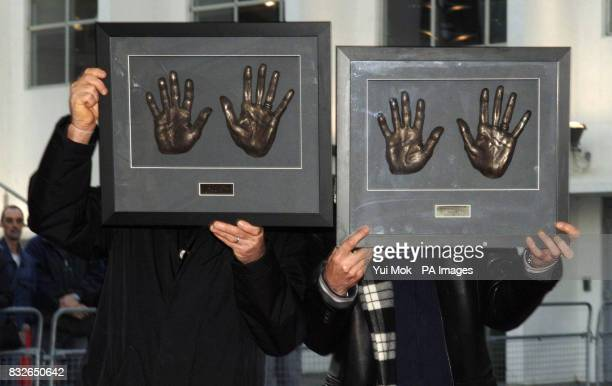 Rock legends Status Quo Rick Parfitt and Francis Rossi during the unveiling of the plaque of their handprints at Wembley's Square of Fame in north...