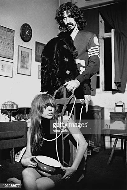 Rock musician and composer Frank Zappa and his wife Gail pose for a portrait at home in 1967 in Los Angeles California