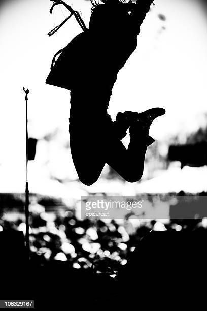 Rock musician leaping through the air