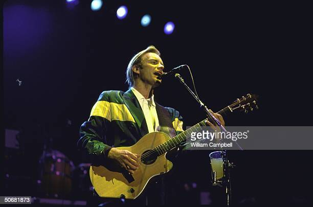 Rock musician Sting performing during Amnesty International's Human Rights Now concert tour