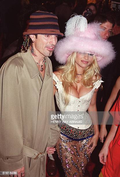 Rock musician Tommy Lee and his wife actress Pamela Anderson Lee arrive for the MTV Video Music Awards at the Metropolitan Opera House at Lincoln...