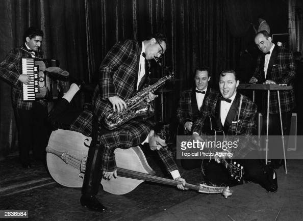Rock 'n' roll group Bill Haley And His Comets famous for the song 'Rock Around the Clock' seen here during rehearsals in London for their first...