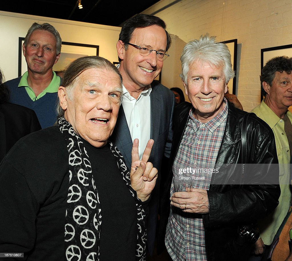 Rock n' Roll photographer Henry Diltz, CBS News correspondent Anthony Mason and musician and photographer <a gi-track='captionPersonalityLinkClicked' href=/galleries/search?phrase=Graham+Nash&family=editorial&specificpeople=208239 ng-click='$event.stopPropagation()'>Graham Nash</a> attend the <a gi-track='captionPersonalityLinkClicked' href=/galleries/search?phrase=Graham+Nash&family=editorial&specificpeople=208239 ng-click='$event.stopPropagation()'>Graham Nash</a> Photo Exhibit Opening at the Morrison Hotel Gallery on April 25, 2013 in New York City.