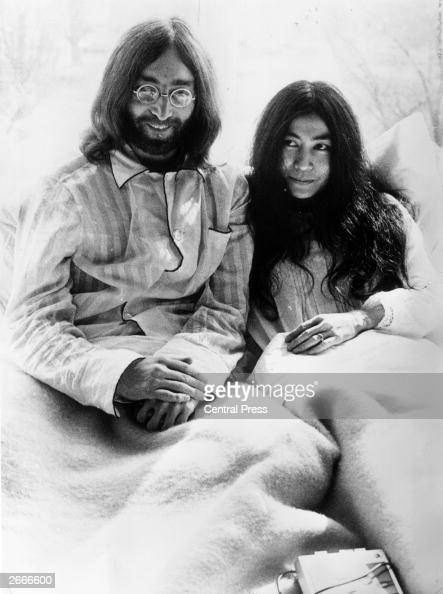 Rock 'n' roll singer songwriter and guitarist John Lennon of The Beatles with his wife of a week artist Yoko Ono in bed in the presidential suite of...