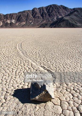 Rock on dry lake