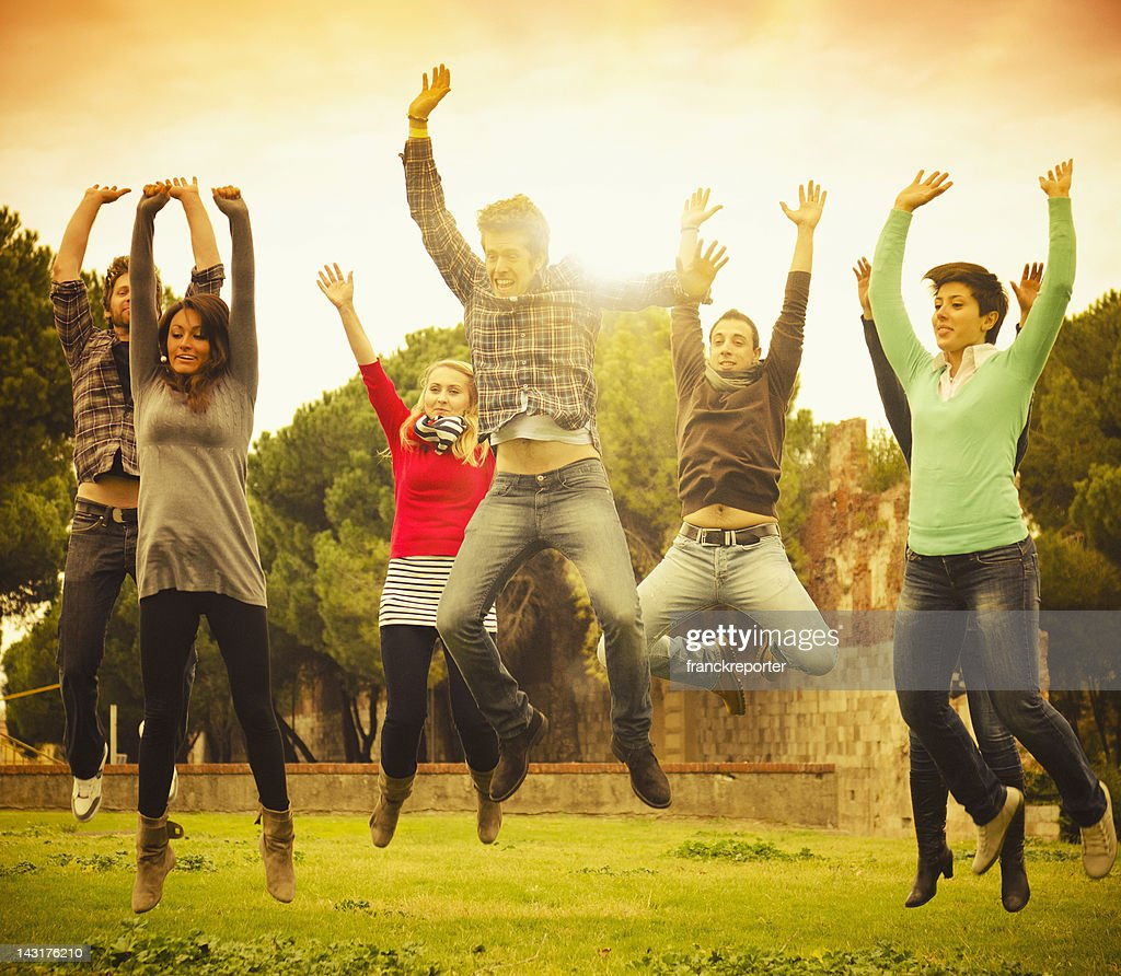 Rock On !! Group of latin people jumping : Stock Photo