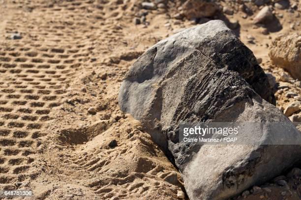 Rock on sand