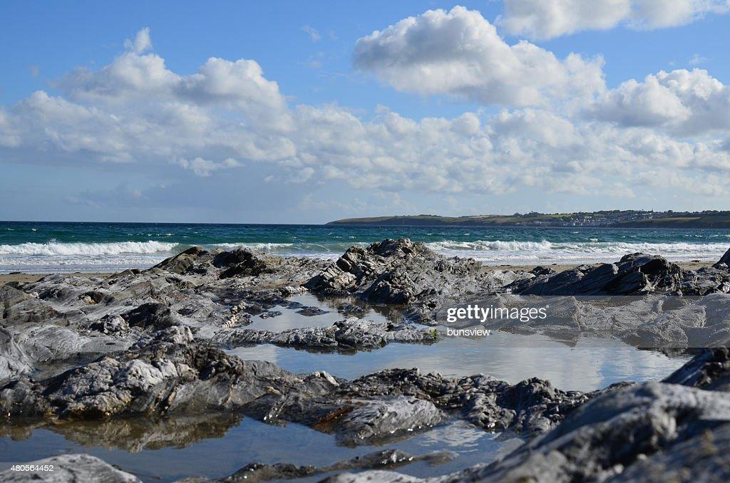 Rock pool along Carne beach in Cornwall. : Stock Photo