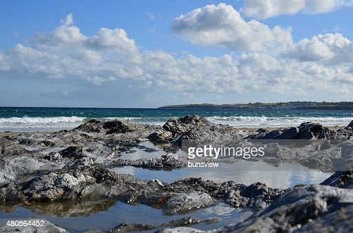 Rock pool along Carne beach in Cornwall. : Stock Photo