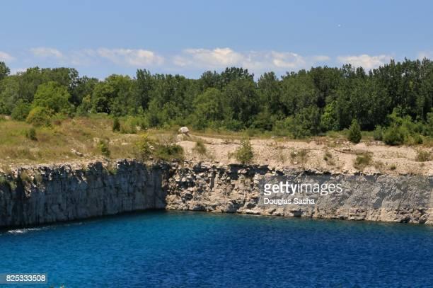 Rock quarry of limestone in an open pit mine