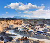 Rock quarry with trucks and all equipment.
