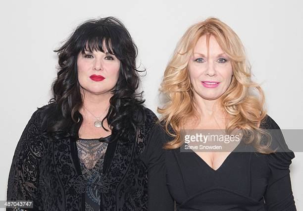 Rock Roll Hall of Fame inductees Ann and Nancy Wilson of HEART pose backstage before their performance at Route 66 Casinos Legends Theater on April...